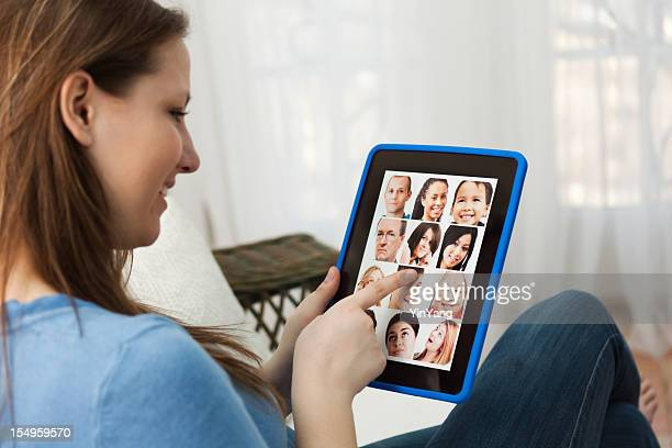 woman enjoying social networking with digital tablet computer - girl sitting on boys face stock photos and pictures
