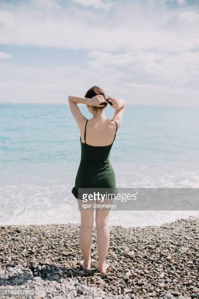woman enjoying summer vacation - human back stock pictures, royalty-free photos & images