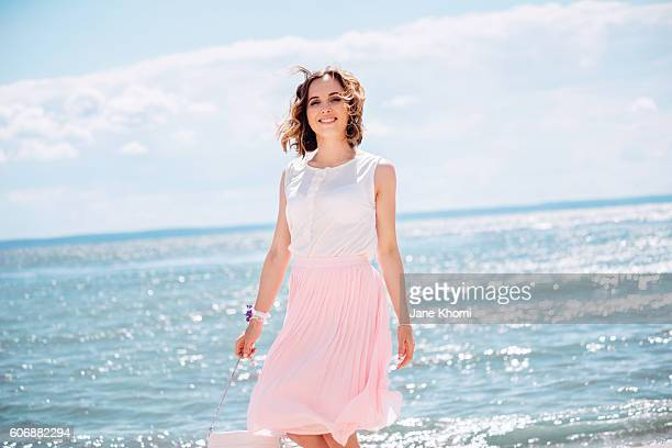 woman enjoying summer vacation - wind blows up skirt stock pictures, royalty-free photos & images