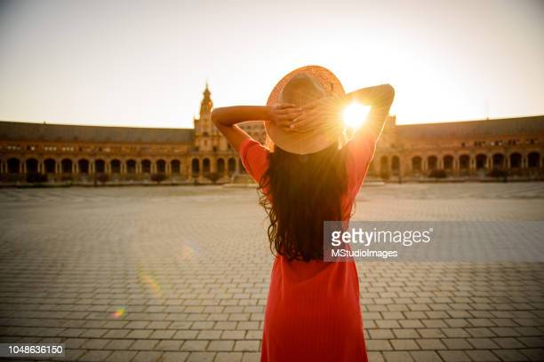 woman enjoying sunrise. - seville stock pictures, royalty-free photos & images