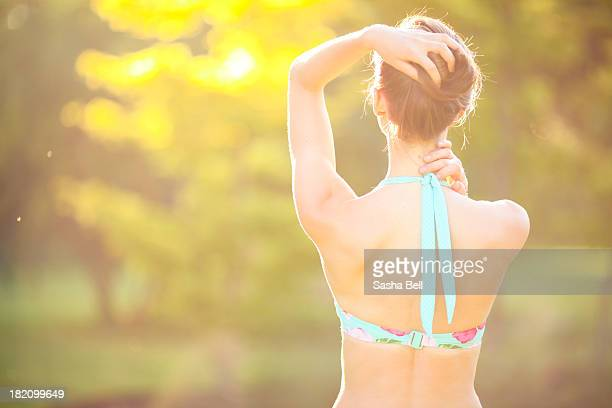 Woman enjoying sunshine in bikini.