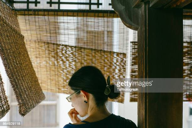 woman enjoying the cool air of summer evening - matsuyama ehime stock pictures, royalty-free photos & images