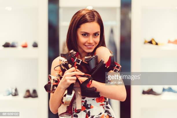 woman enjoying the day in the shopping mall - addict stock photos and pictures