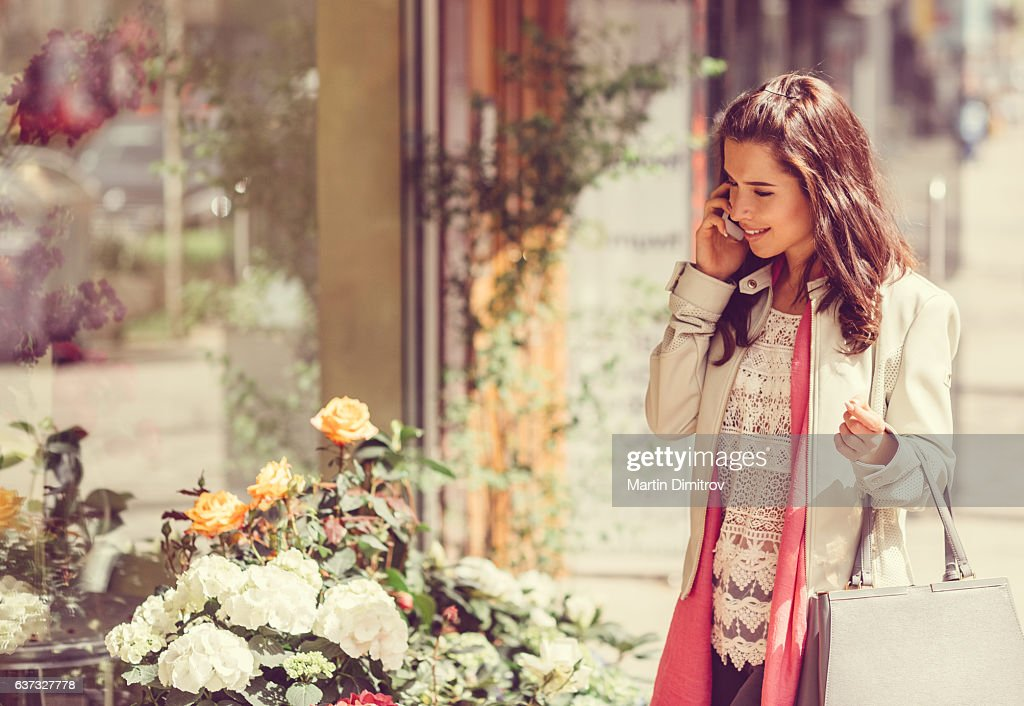 Woman enjoying the flowers : Stock Photo