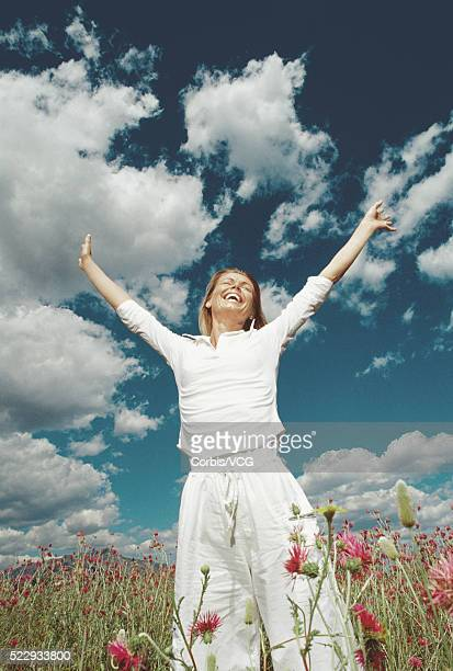 woman enjoying the outdoors - vcg stock pictures, royalty-free photos & images