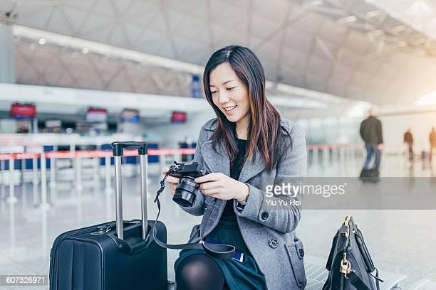 Woman enjoying the photos taken by camera