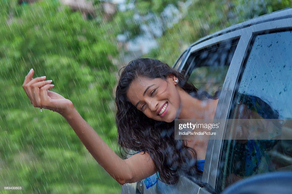 Woman enjoying the rain : Stock Photo