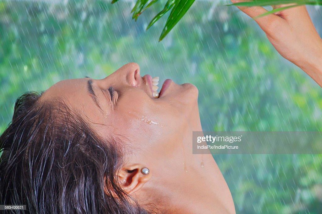 Woman enjoying the rain : Stock Photo