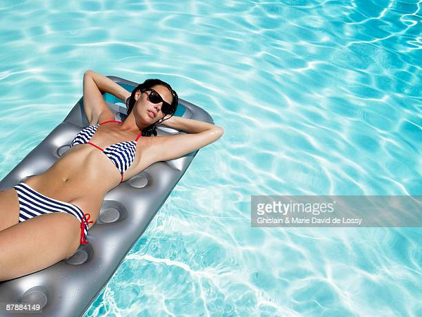 Woman enjoying the sun on air mattress