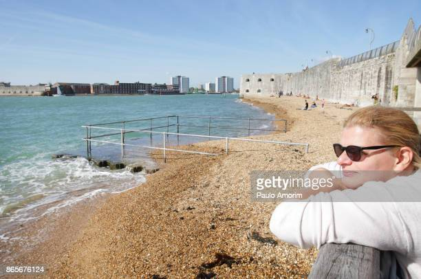A woman enjoying the view at Portsmounth Harbour,UK
