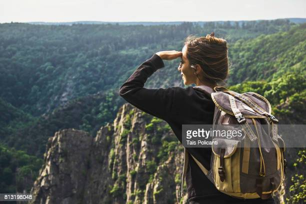 Woman enjoying the view of Bodetal valley in Thale - Hexentanzplatz (Witches' Dance Floor), Harz mountains, Thale, Saxony-Anhalt, Germany