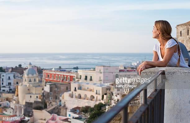 woman enjoying the view of Procida Island, Italy