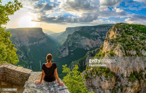 woman enjoying the view of vikos canyon in greece - epirus greece stock pictures, royalty-free photos & images