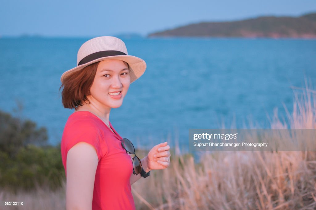 Woman enjoying the view on the hill : Stock Photo