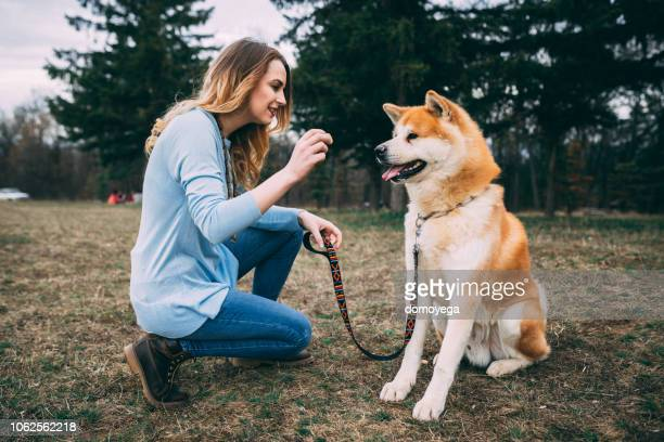 Woman enjoying time with her pet dog in the public park