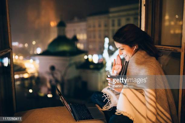 woman enjoying to be home for christmas - honour stock pictures, royalty-free photos & images