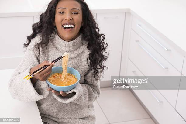 Woman enjoying Tom Yum soup.