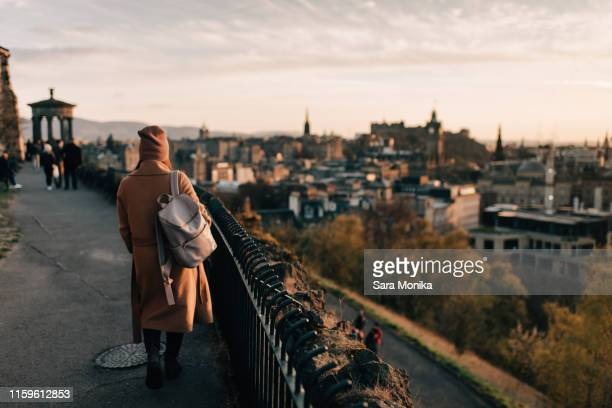 woman enjoying view from calton hill, edinburgh, scotland - エディンバラ ストックフォトと画像