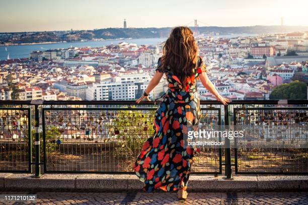 woman enjoying view from miradouro da senhora do monte in lisbon, portugal - lisbon stock pictures, royalty-free photos & images