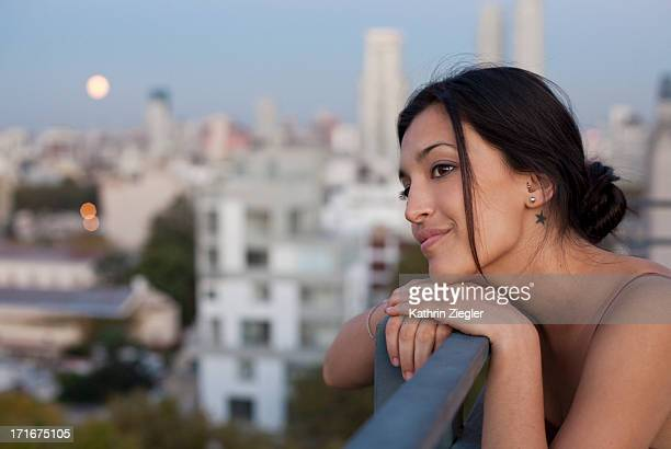 woman enjoying view from terrace at full moon - argentina women stock pictures, royalty-free photos & images