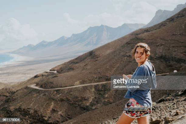 Woman enjoying view to sea, Corralejo, Fuerteventura, Canary Islands
