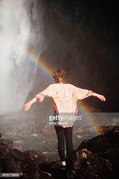 Woman Enjoying Waterfall
