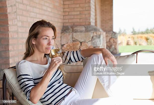 Woman enjoying wine on the terrace