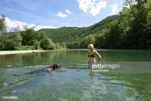 a woman enjoying with her dog during summer in france - aveyron photos et images de collection