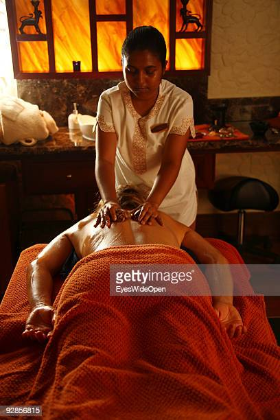 Woman enjoys a Ayurveda health treatment with a Kauri shellin the luxurious ShangriLa's Villingili Resort and Spa Hotel on September 27 2009 in Male...
