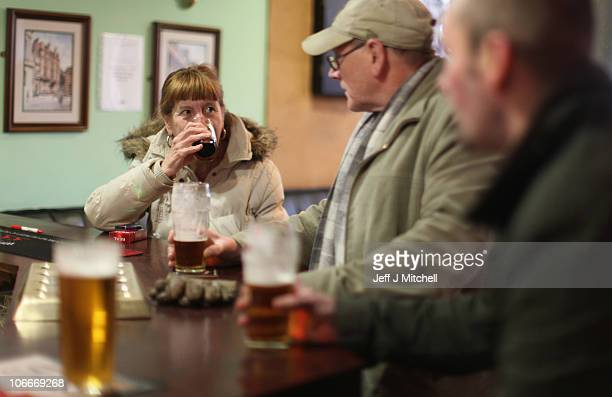 A woman enjoys a drink in a Govan pub on November 10 2010 in Govan Glasgow Scotland MSP's are set to vote on the SNP government's Alcohol Bill aimed...