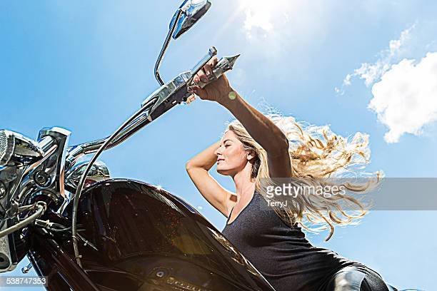 Woman Enjoys a Motorcyle Ride on Sunny Day