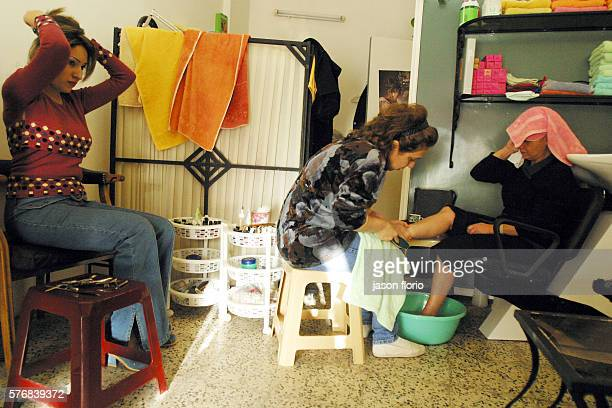 A woman enjoys a pedicure at Sehams beauty salon in Baghdad As the feeling of loss of all that is normal grows more apparent the women of Baghdad...
