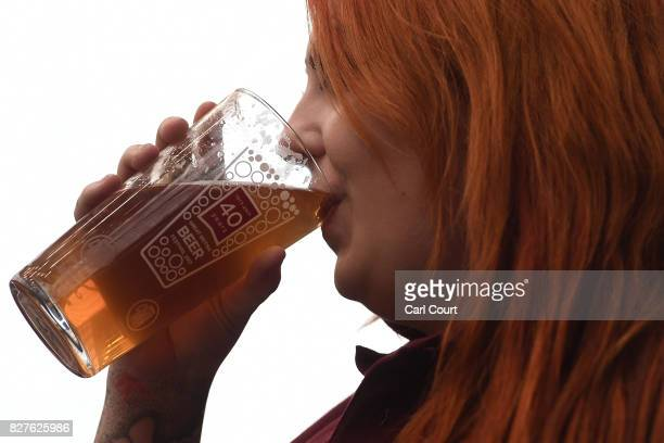 A woman enjoys a pint of ale at the CAMRA Great British Beer festival at Olympia exhibition centre on August 8 2017 in London England The five day...