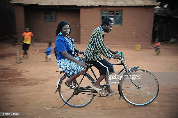 A woman enjoys a ride on one of the bicycle taxi on May 6 2015 in Malawi Bicycle taxis known as kabazas in Chichewa are a cheaper form of transport...