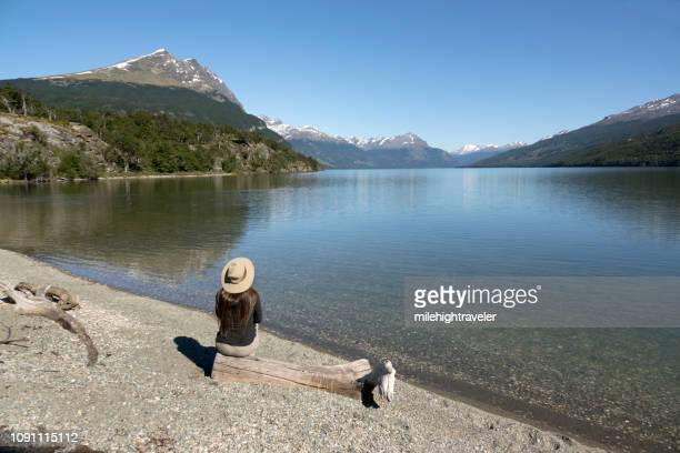 Woman enjoys Acigami Lake Darwin Mountains Tierra del fuego National Park Argentina