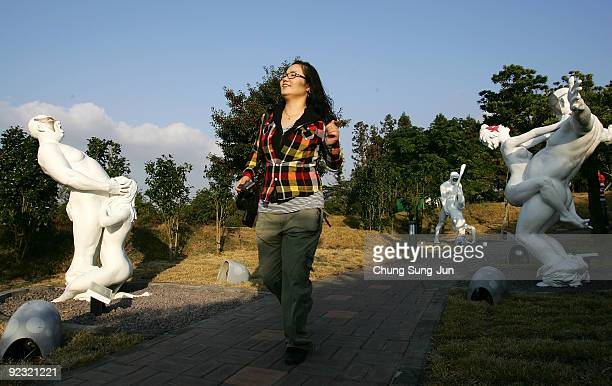 A woman enjoys at theme park 'Love Land' on October 24 2009 in Jeju South Korea Love Land is an outdoor sexthemed sculpture park which opened in 2004...