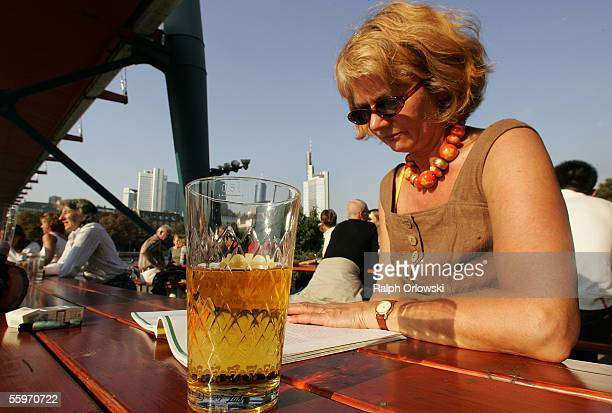 A woman enjoys her cider near the banks of river Main on September 24 2005 in Frankfurt Germany Frankfurt is one of the host cities that will be used...