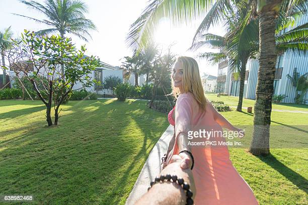 Woman enjoys sunlight in resort garden area