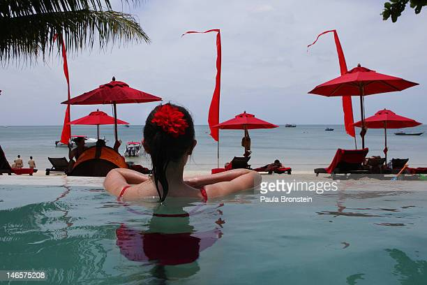 A woman enjoys the beachside pool at the Anantara Rasananda resort June 18 2012 on the island of Koh Phangan off the coast of Koh Samui Thailand's...
