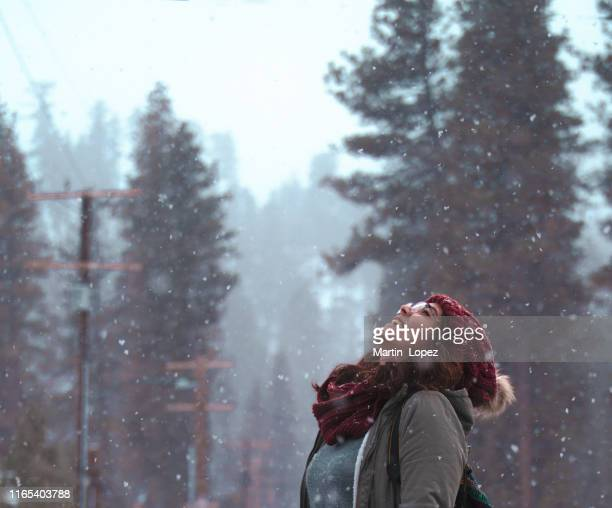woman enjoys the snow - warm clothing stock pictures, royalty-free photos & images