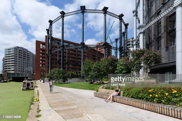 A woman enjoys the sunshine as she relaxes near Gasholder Park on July 22 2019 in London England On July 22 London officially became the world's...