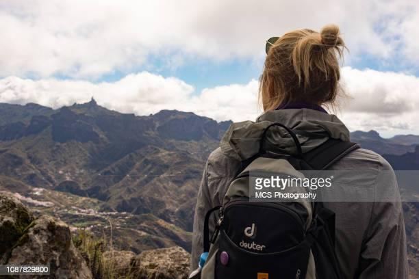 Woman enjoys the view on Roque Nublo