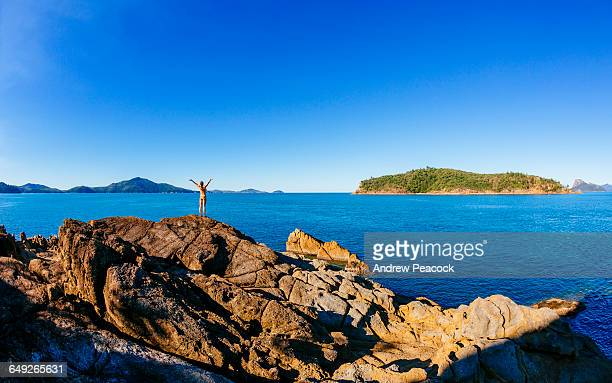 A woman enjoys the view to Perseverance Island