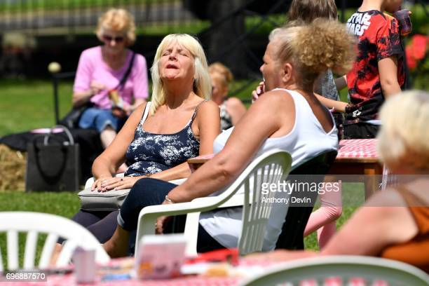 A woman enjoys the warm weather as people attend a Great Get Together event in memory of murdered MP Jo Cox on June 17 2017 in Heckmondwike England...