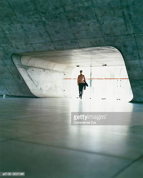 woman entering concourse - modern rock stock pictures, royalty-free photos & images