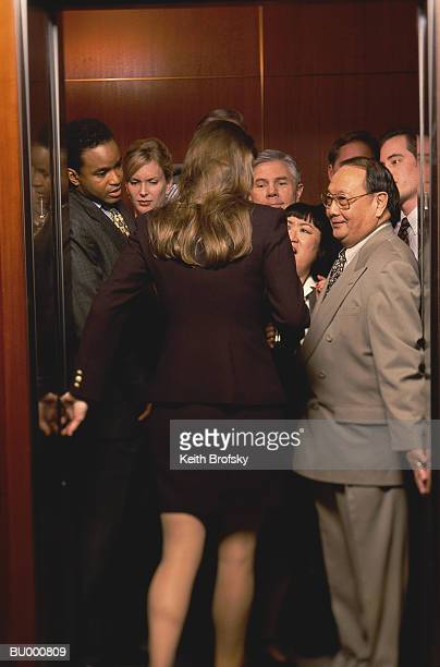 Woman Entering Crowded Elevator