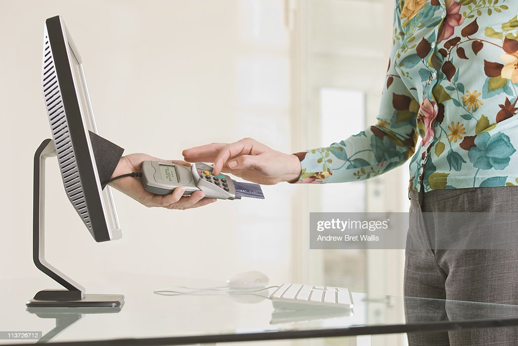 woman entering pin for an on-line transacation : Stock Photo