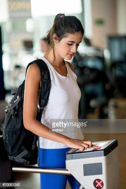 Woman entering the gym with a fingerprint scan