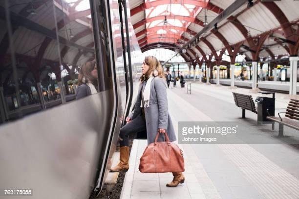 Woman entering train