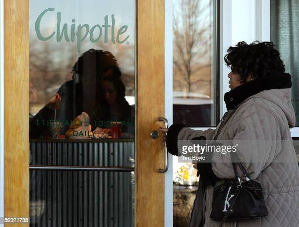 A woman enters a Chipotle restaurant December 2 2005 in Glenview Illinois McDonald's Corp owners of 92 percent of Chipotle are preparing their...
